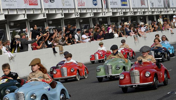 (Chichester, UK) Children take part in the Settrington Cup pedal car race as motoring enthusiasts attend the Goodwood Revival, a three-day historic car racing festival    Photograph: Toby Melville/Reuters