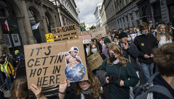 (Warsaw, Poland) Placard-bearing protesters march as part of the 'Fridays for Future' global protests against climate change || Photograph: Attila