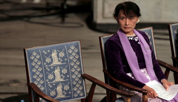 Myanmar opposition leader Aung San Suu Kyi sits before giving her Nobel Lecture at City Hall in Oslo, June 16, 2012. || Reuters Photo: Collected