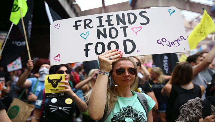 (London, England) An animal rights protestor holds a placard during a march through central London as part of the Extinction Rebellion's August protests    Photograph: Hollie Adams/Getty Images